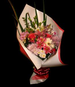 cod 201 - Ramo multicolor con gerberas, liliums, margaritas, flores varias y verde acorde