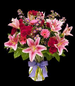 cod 308 - Florero de vidrio con liliums rosados, rosas rojas, gerberas, reinas y follaje al tono